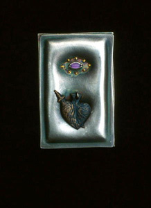 5.36 'Milagros for a Heart of Gold' 1991. Brooch; white metal, amethyst, gold
