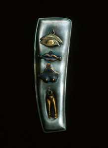 5.37 'Milagros for Eternity' 1991. Brooch; white metal, mixed media