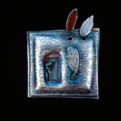 5.38 'Emergence' 1991. Brooch; white metal (oxidised), amber