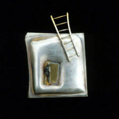 5.40 'Moving Up' 1991. Brooch; white metal, gold plating