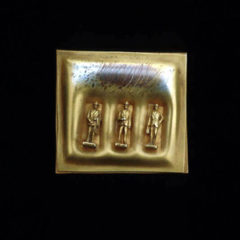 5.45 'Life in the City' 1992. Brooch; white metal, gold plated and oxidised