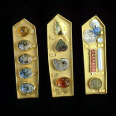 5.63 'Collecting Box' 1999. 3 Brooches; white metal (gold plated), amber, granite, mixed media, found objects