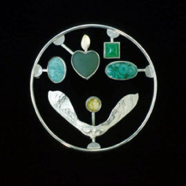 6.10 'Love Kit' 2001. Brooch; white metal, malachite, agate, Iona marble