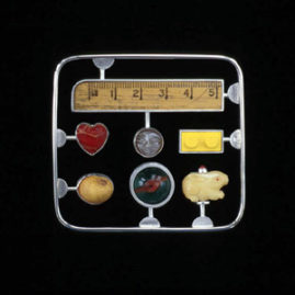 6.17 'Memory Kit' 2003. Brooch; white metal, mixed media, readymade