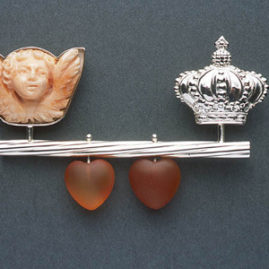 7.38 'Your Love is King' 2003. Brooch; white metal, coral, carnelian