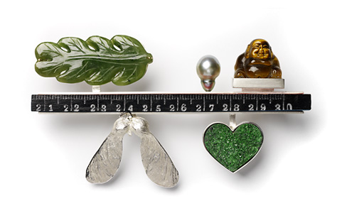 7.65 'Fragments' 2006. Brooch; white metal, tiger eye, green coral, nephrite, cultured pearl, wood